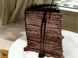 Watch These People Struggle To Eat A 48-Layer Cake