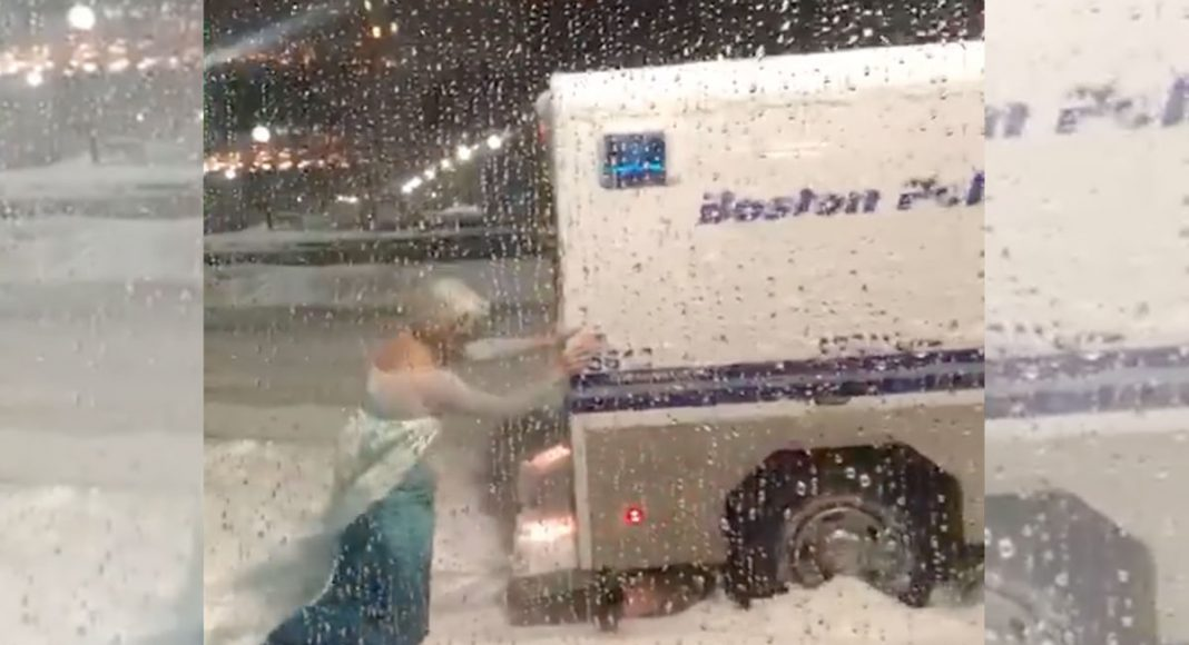 Another Nor'easter! Man Dressed As Elsa Pushes Police Wagon Out Of Snowbank