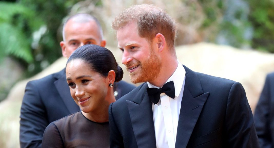 royal insider says meghan markle continues to struggle with intensity of spotlight