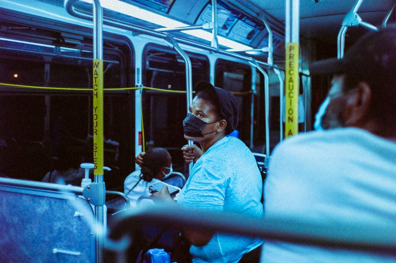 woman in blue sweater sitting on bus seat