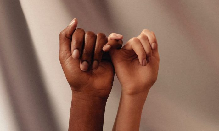 persons hand with white manicure