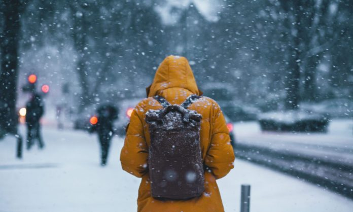 Should You Clean Your Winter Coat More Often In A Pandemic? Here's What Experts Say